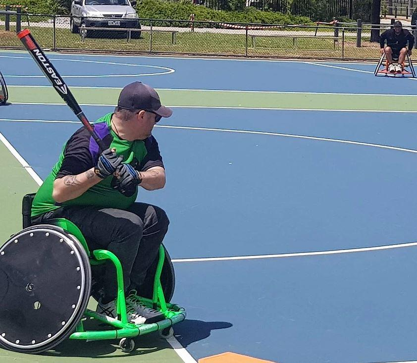 Man in wheelchair playing softball